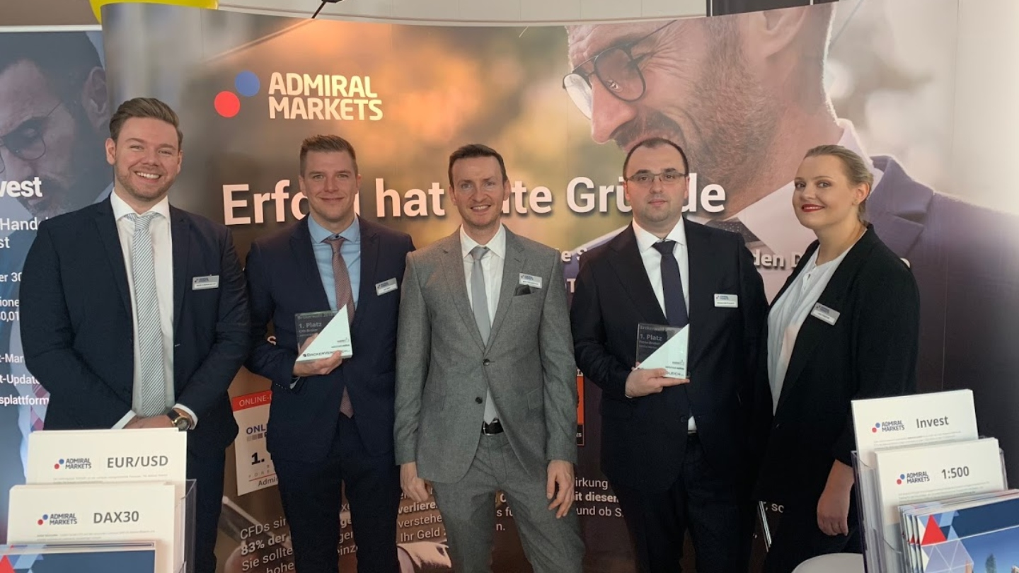 Admiral Markets team posing with awards